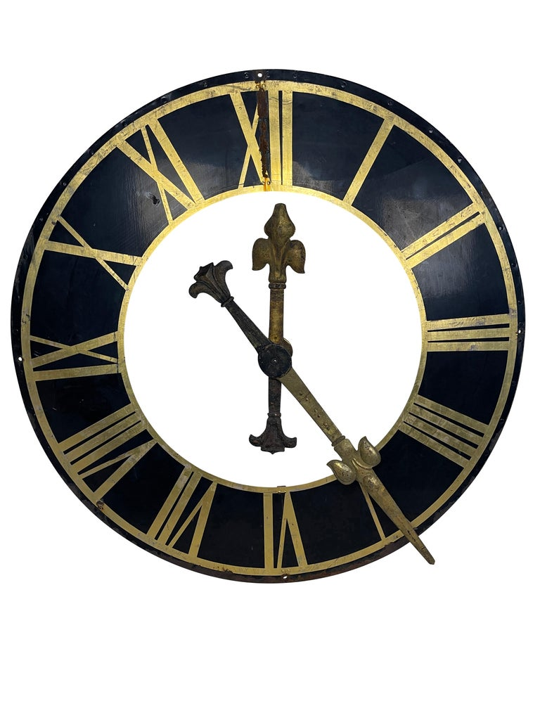 A large antique 19th century original black metal clock face, gilt roman numerals, and gilt hands. Beautiful patina to the dial and hands. For garden or interior use. Very elegantly designed, good structural condition. No mechanism.  circa