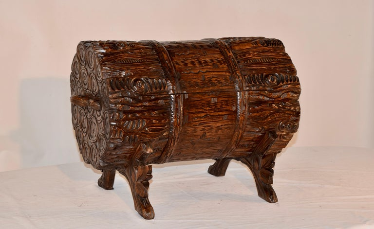 19th century masterfully hand carved Black Forest trunk in the shape of a bundle of logs. This top opens to reveal a lined storage area. This is supported on hand carved and shaped legs which are in the form of branches with leaf decoration.