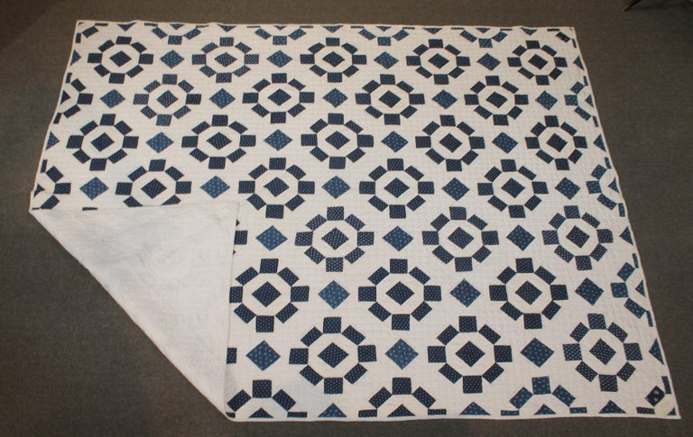 19th century blue and white geometric quilt with very nice quilting and piece work. The condition is very good condition.