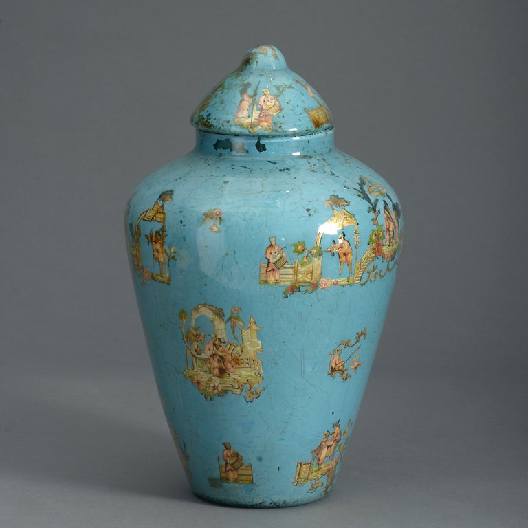 A charming mid-nineteenth century pale decalcomania vase and domed lid, decorated throughout with chinoiseries on a pale blue ground.  This is an unusual example of decalcomania. The decoupage work closely resembles arte povera of the eighteenth