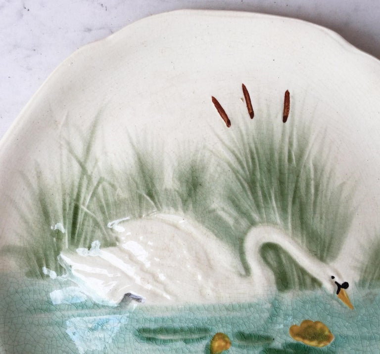 Majolica plate with a swan on a pond signed Hippolyte Boulenger Choisy le Roi, circa 1890.