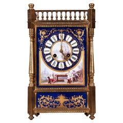 An English Porcelain Clock and Ormolu Garniture