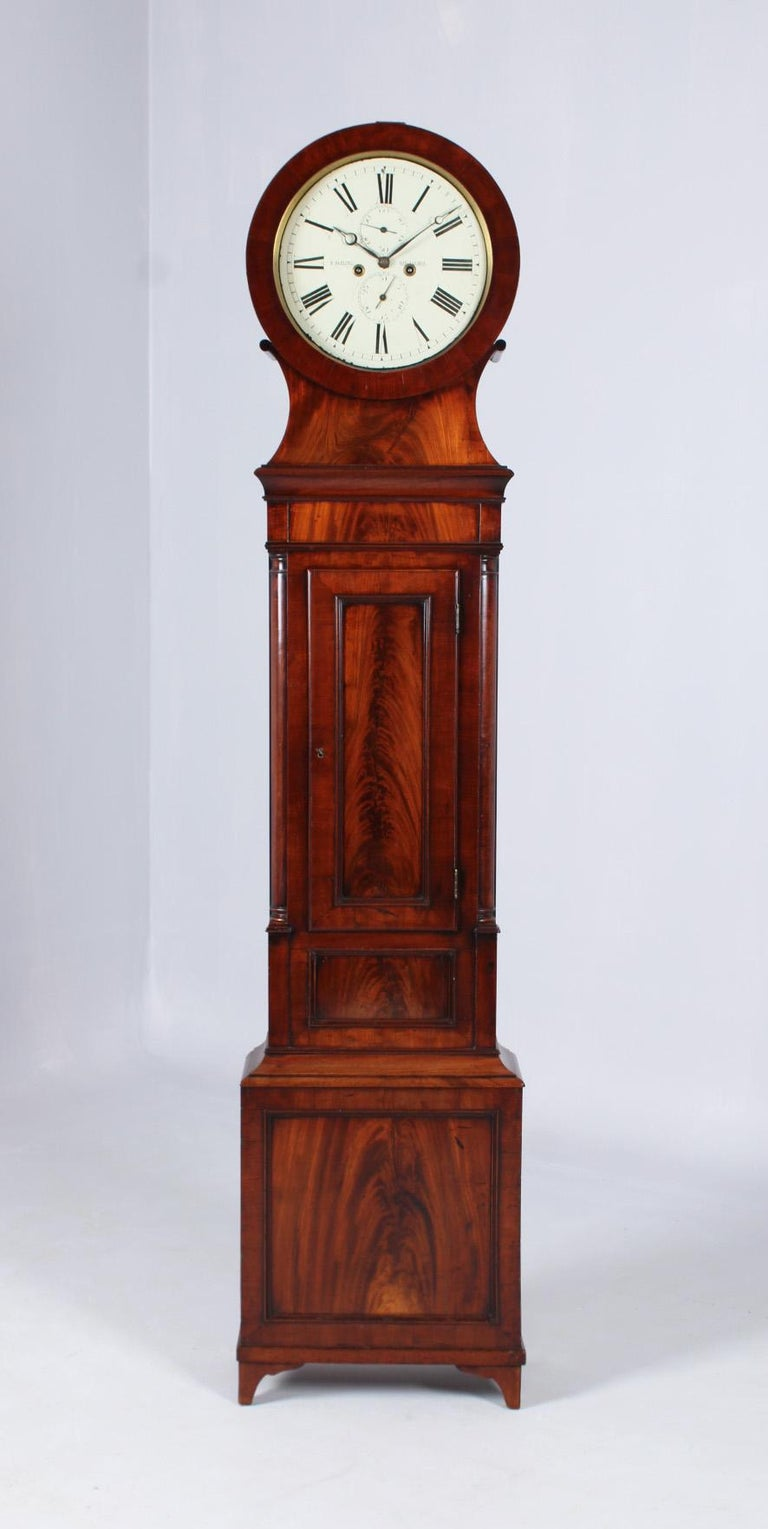 Scotland Mahogany Georgian, circa 1825  Measures: Height 208 cm, width 42 cm, depth 18 cm  Description:  Antique mahogany grandfather clock with seconds pendulum and very attractive dial. Slender longcase standing on delicate cut-out