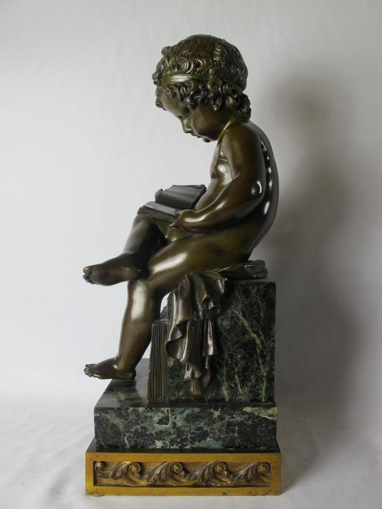 19th century finely cast and patinated bronze depicting a reading child.