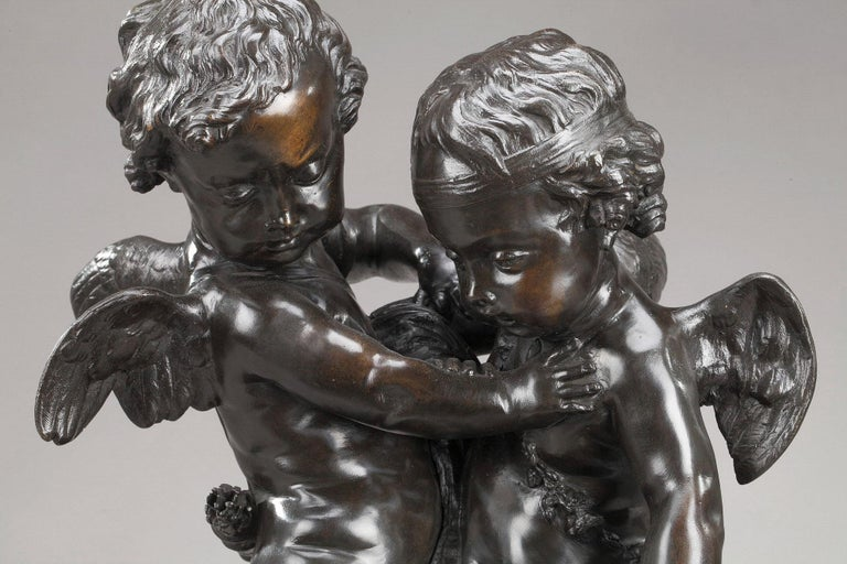 Bronze group with brown patina featuring Cupids fighting over a heart after Etienne-Maurice Falconet (1716-1791). This work had a great success in the second half of the 19th century, and was reproduced in bronze, marble or alabaster. The bronze is