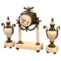 19th Century Bronze Mantel Clock Raised on a Marble Stand with Two Marble Urns