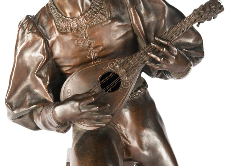 Paul Fournier (French, 1859-1926): A large bronze figure of a minstrel playing a lute the figure in Renaissance dress, looking to dexter and seated on a fountain with lion mask spout and shaped bowl below, on a circular base, signed 'Paul