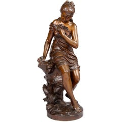 19th Century Bronze Statue of a Young Girl Holding a Bird