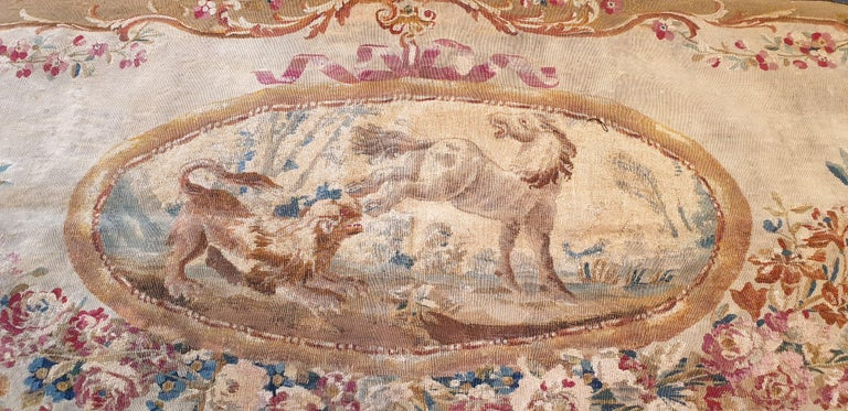 Brussels tapestry handwoven in the 18th century. Representation of a wolf attacking a horse. Contour of flowers and ornaments.  Oval shape. Reinforcement by a fabric on the back of the work. Perfect state of conservation   Measures: W 69.29 in. x H