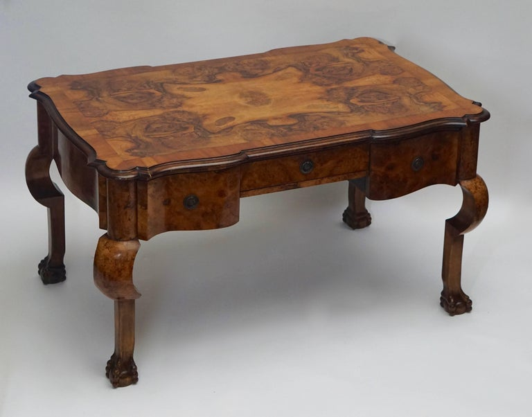 Magnificent 19th century burled walnut partners desk with original armchair and claw legs.  19th century burl walnut partners writing desk with armchair. This desk has functional curved drawers on both sides, a true partner's desk. This desk is