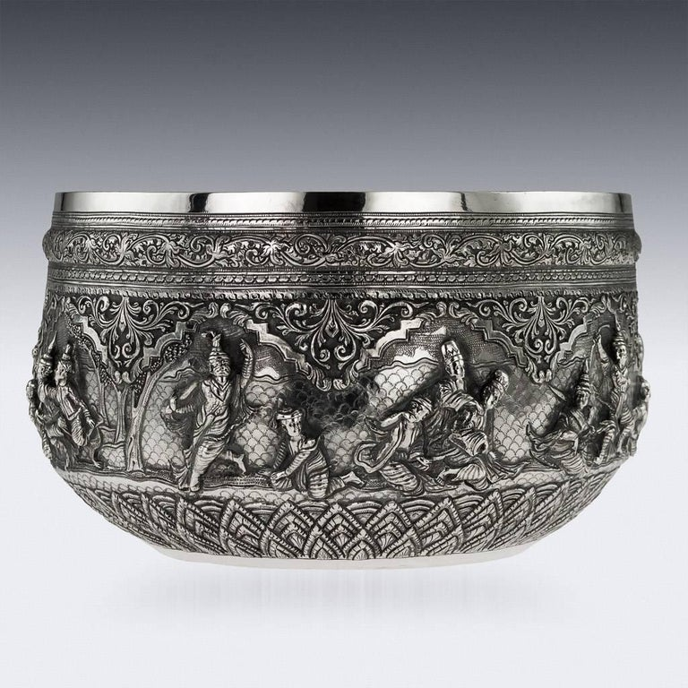 Antique 19th century exceptionally rare Burmese, Myanmar solid silver bowl, repousse' decorated in high relief depicting different traditional scenes from the Burmese mythology, showing detailed figures set against a chiseled matted background in