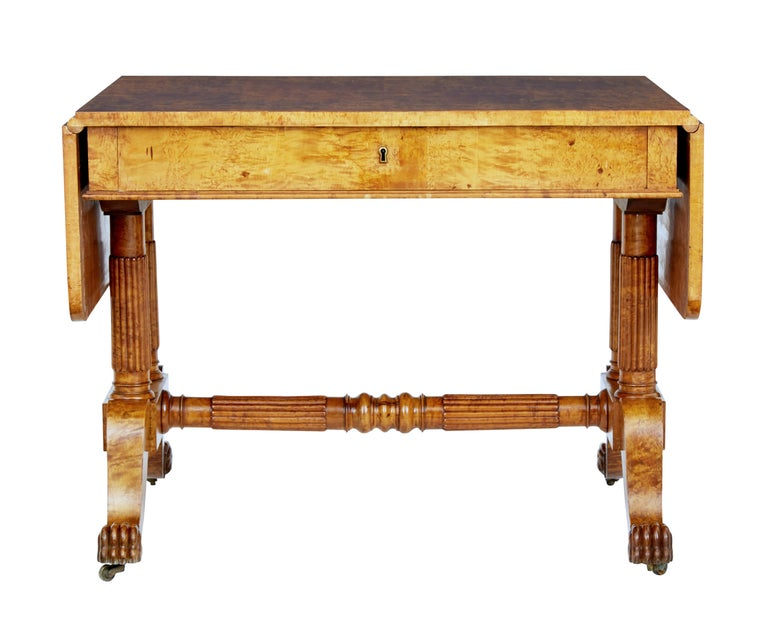 Superb quality Biedermeier period sofa table, circa 1825.  Beautifully made from burr birch, giving it strong grains and color. Drop down flaps provide a overall length of just over 63 inches.  Single deep drawer below the top surface. Standing