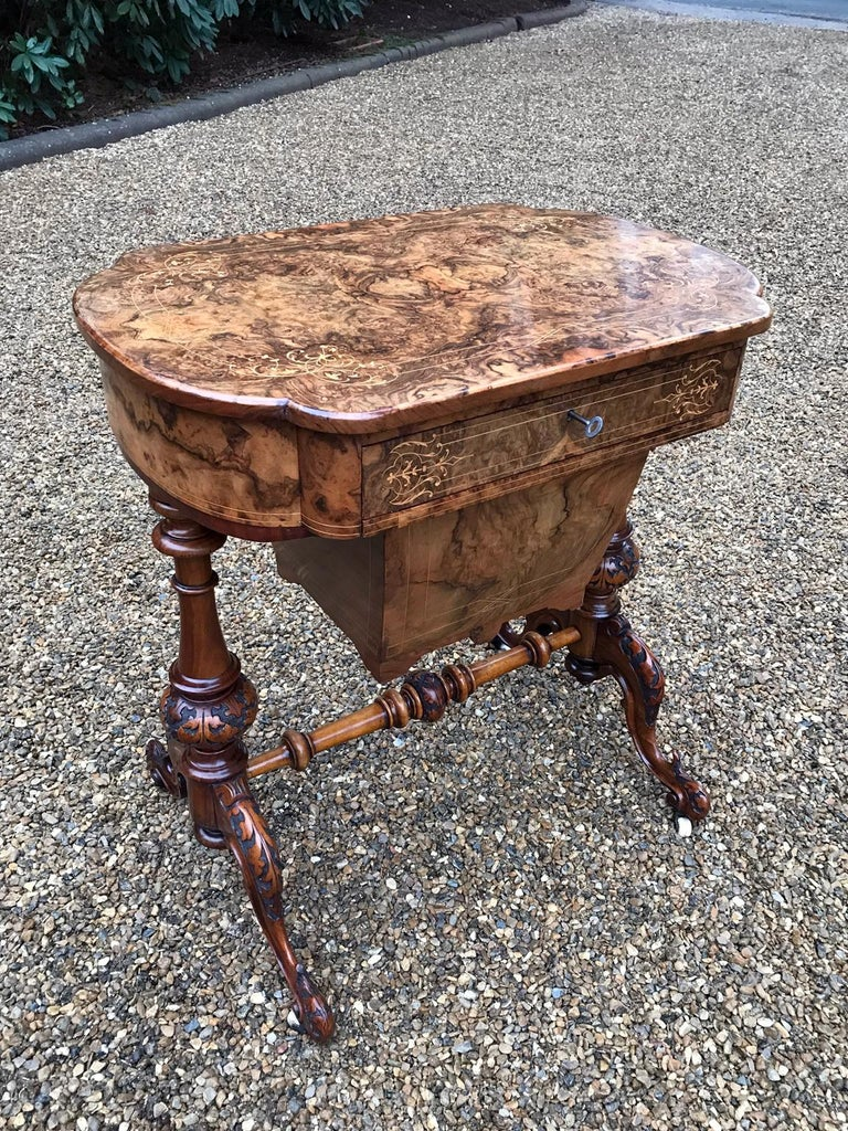 High quality 19th century burr walnut and marquetry work table with a central drawer with fitted compartments, a pull out box section below, turned / carved legs and stretchers,