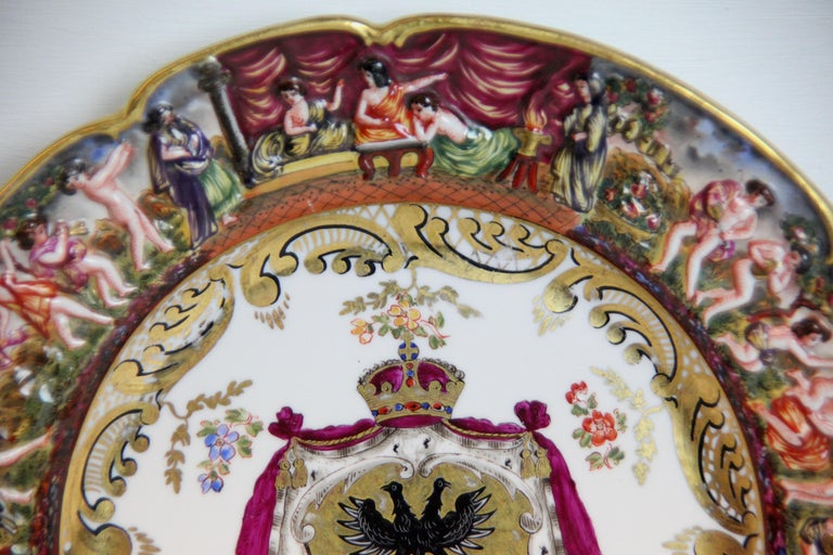 19th century Capodimonte plate, with shaped rim, border featuring classical scenes, the center with coat of arms.