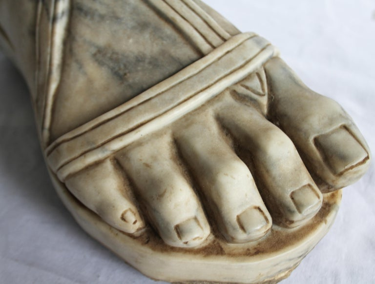 A Carrera marble carving of a Roman Centurion's foot. Italian 19th century. Realistically carved with straps.