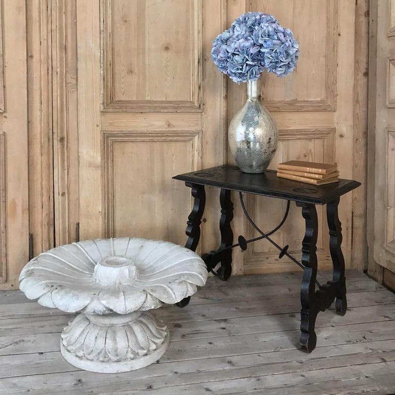 19th century carved Carrara marble garden fountain features a two piece design which makes it easy to install, move, and clean. Designed to last for centuries, circa 1890s Measures: 11.5 height x 24 in diameter.