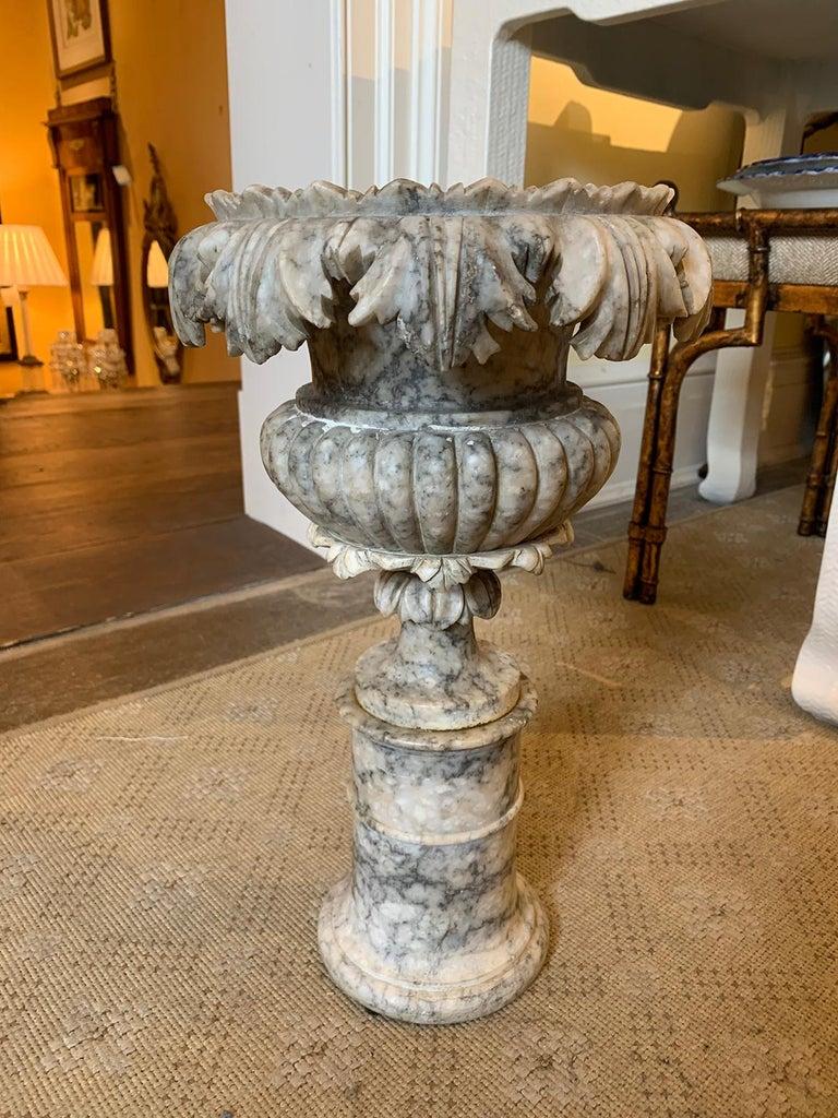 19th century carved Carrara marble urn.