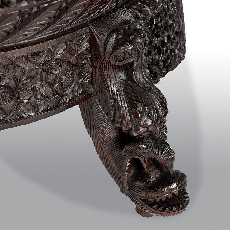 A 19th century carved filigreed Burmese chair of large proportions, with exceptional carving.