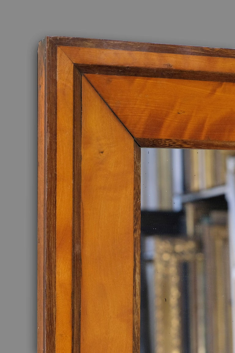 A 19th century French Biedermeier frame with an architrave profile. The frame is veneered in Cherrywood with darker stained borders, and retains its original patina. Further information on this style of frame available on request.   The frame can