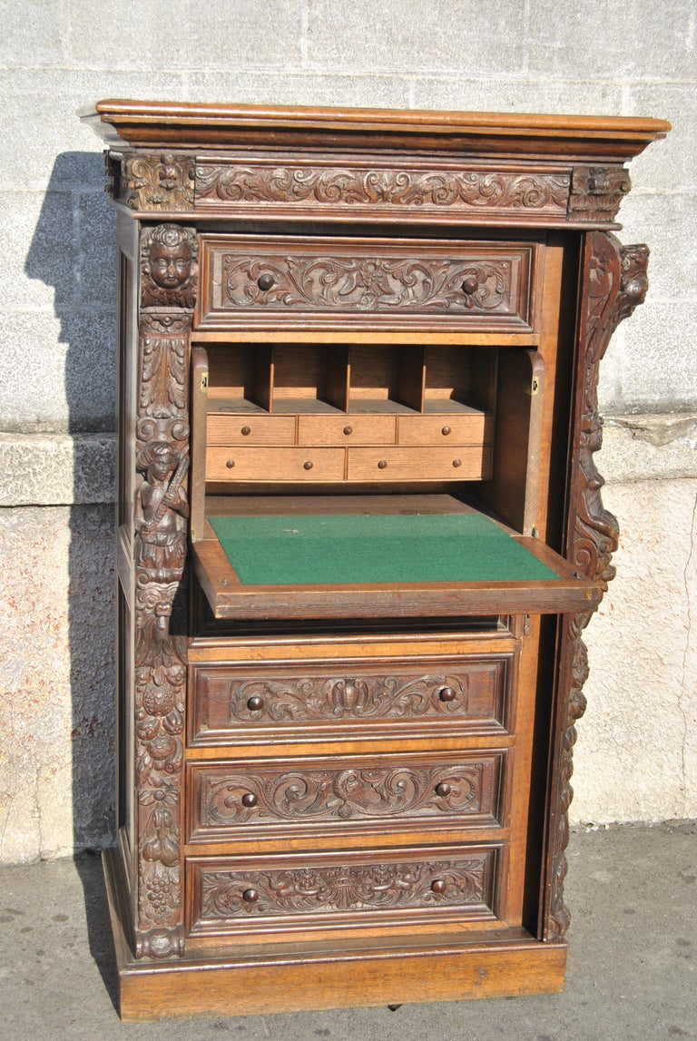 This is a solid oak wellington chest/lingerie chest/secretary made in England, circa 1880. The top of the chest has a nicely molded edge. The chest has incredible quality, very ornate and deep hand carving throughout. Like all true Wellington Chests