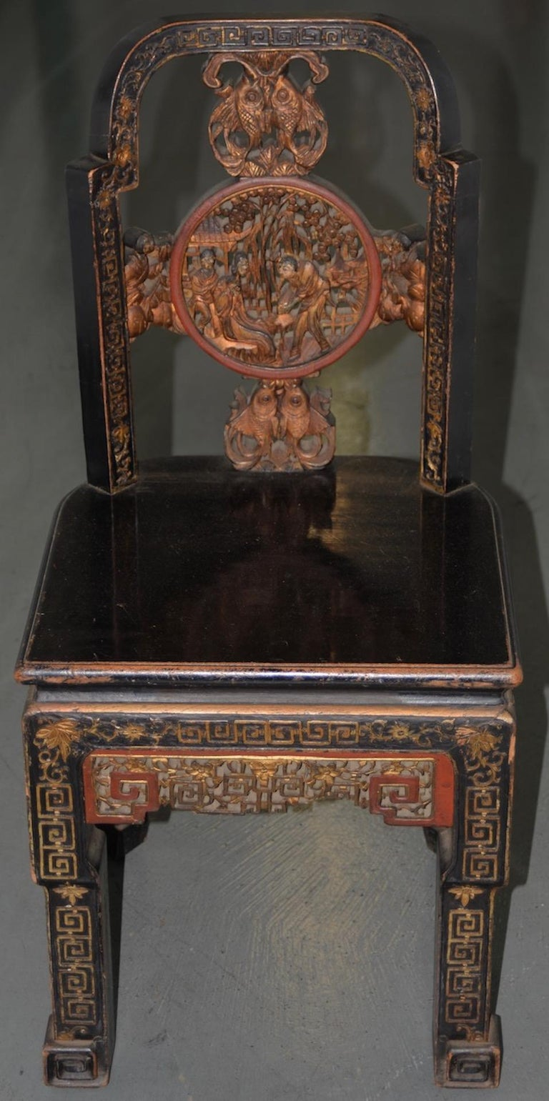 19th century carved & painted Chinese side chair  Brilliant 19th century carved Chinese side chair with ample remains of original paint. The intricate hand carved detail surrounding this chair is stunning. The dark red & gold paint shows nicely