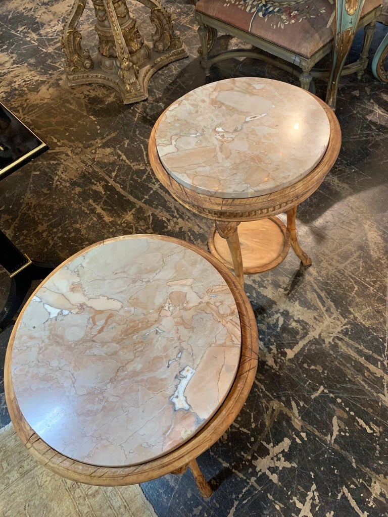 Gorgeous 19th century carved pine neoclassical gueridon side tables. Interesting carvings of ram's heads on the legs and lovely marble top. Very special!