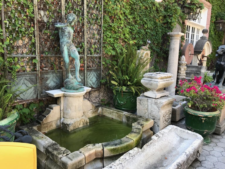 19th century beautifully carved limestone stone fountain basin with a back pedestal stone base and mounting a very nice 19th century large cast bronze of a boy's figure blowing a horn. The Bronze statue fountain piece made with elaborate detailed