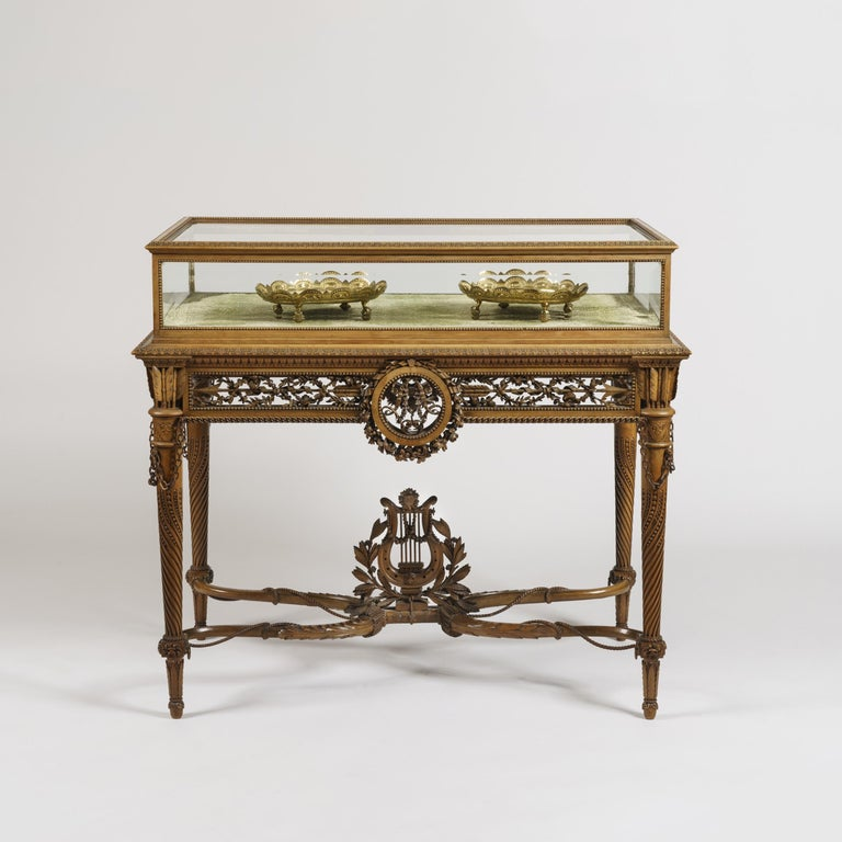 A Tour de Force table Vitrine in the Louis XVI Manner by Alfred-Emmanuel-Louis Beurdeley, of Paris  Of free-standing form, constructed in a finely patinated fruit wood, adorned with carving of finest Exhibition quality; rising from tapering, turned