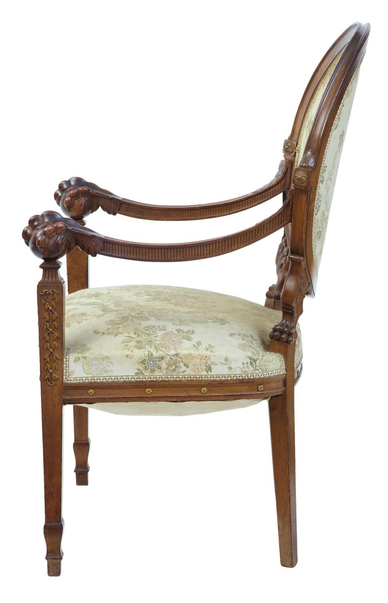 19th century carved walnut french armchair circa 1890.  Good quality armchair with shaped back. Carved and fluted arm rests lead to a deep carved ball and claw arm. Applied carving to front legs.  Some surface staining to upholstery but in
