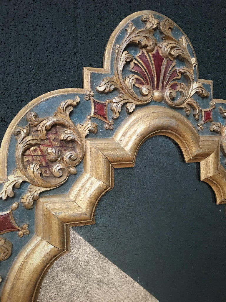 An exceptionally rare, early 19th century carved wood Gothic style mirror, possibly continental. Our restoration team have carefully dry scraped the mirror to remove over-layers, revealing a highly decorative original painted sand-work and oil