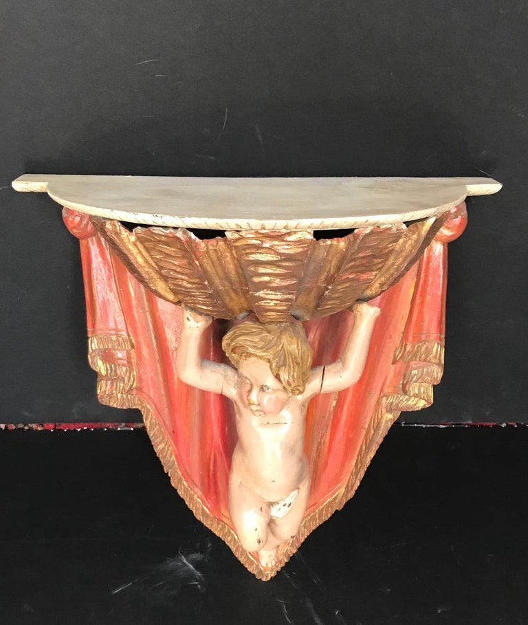 Hand-Carved 19th Century Carved Wood Polychrome and Gilt Putto Hanging Shelf For Sale