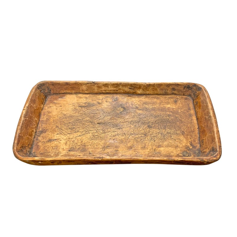 A wonderful 19th century tray hand carved of one piece of wood, with slightly tapered walls, myriad knife marks, and a wonderful patina only time can bestow. Perfect for serving foods at your next party, or collecting the day's mail on a table in