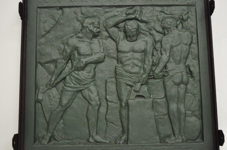 Rare antique cast iron fireback depicting foundry workers. Item features heavy cast iron construction, three impressive relief cast figures of male foundry workers, green finish, weighs approximate 100 lbs., very rare antique item, circa 19th