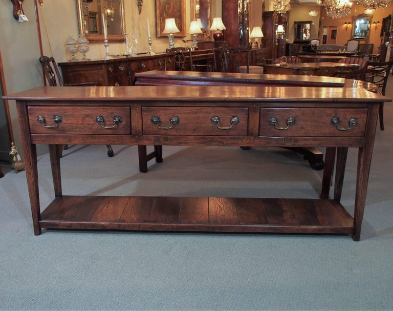 Antique French Provincial chestnut dresser base with pot board.