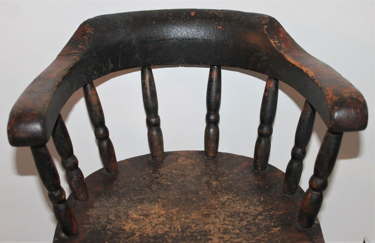 This fine mid western Child's captain's chair in original painted surface is in great condition. Fantastic for a teddy bear collection or little child. This chair has wonderful aged wear and nice patina.
