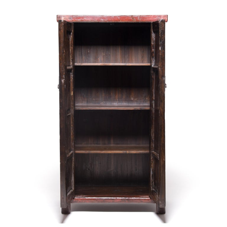 This richly lacquered cabinet from China's Shanxi province is over a century and a half old, with a finish that has acquired wonderful character and texture with age. Collectors appreciate cabinets configured like this—with doors that span full