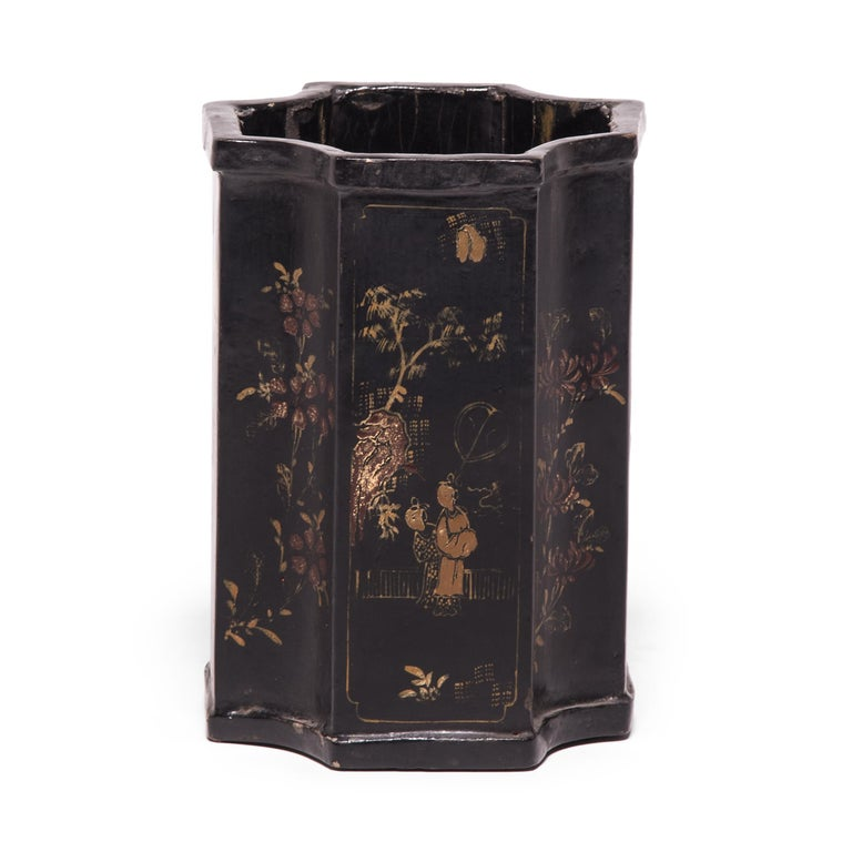 This black lacquered brush pot, which was an essential fixture of a scholar's studio, is hand painted with alternating depictions of garden scenes and flower motifs. These ornate gilt paintings have mellowed beautifully, revealing a depth of