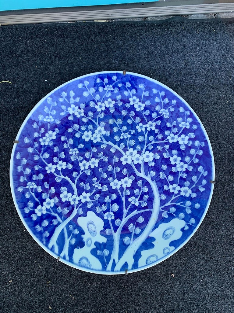 Large scale 19th century Chinese blue and white cherry blossom round porcelain charger.
