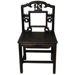19th Century Chinese Carved Wooden Chair with Cherry Blossoms and Dark Lacquer