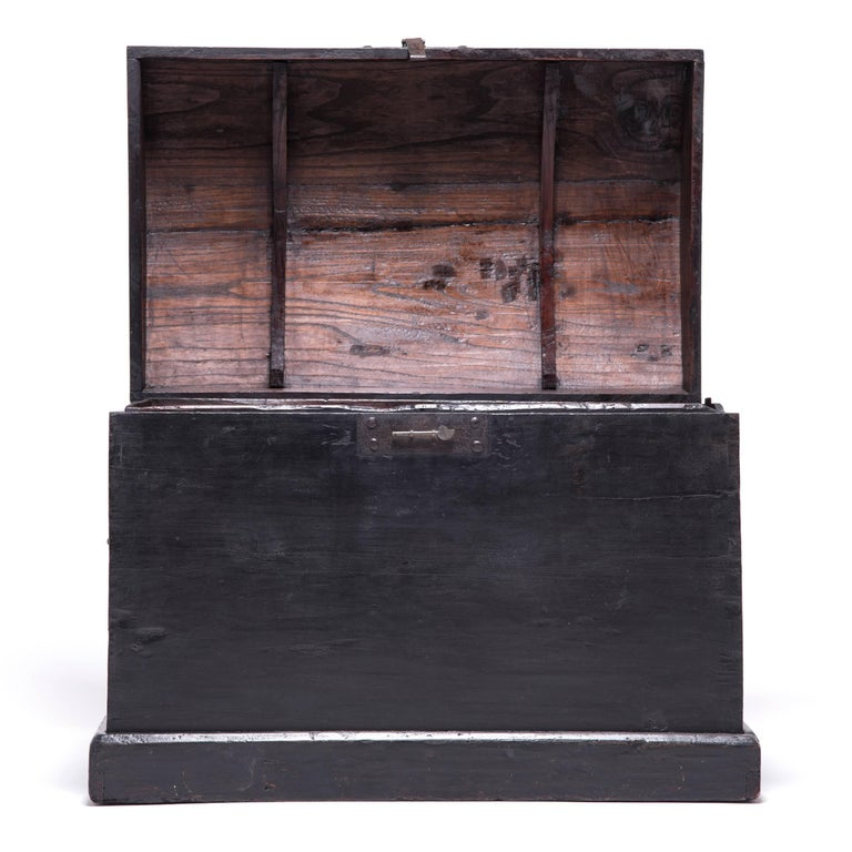 This rustic pine trunk dating from the Qing dynasty projects quiet harmony and balance. Simple in design and bare of ornament except for its brass hardware, the trunk epitomizes the austerity of classical Chinese furniture design. Made in Hebei