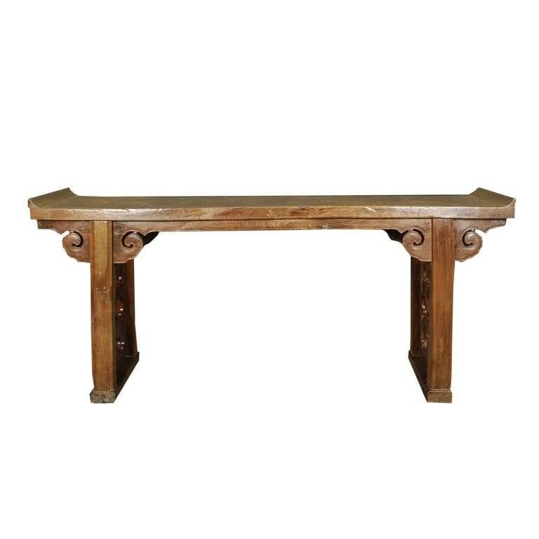 A prime example of Qing dynasty furniture, this 19th century table from Shanxi, China is beautifully proportioned and combines practical considerations with aesthetic principles. Its top is carved from a solid, significant walnut timber and the legs