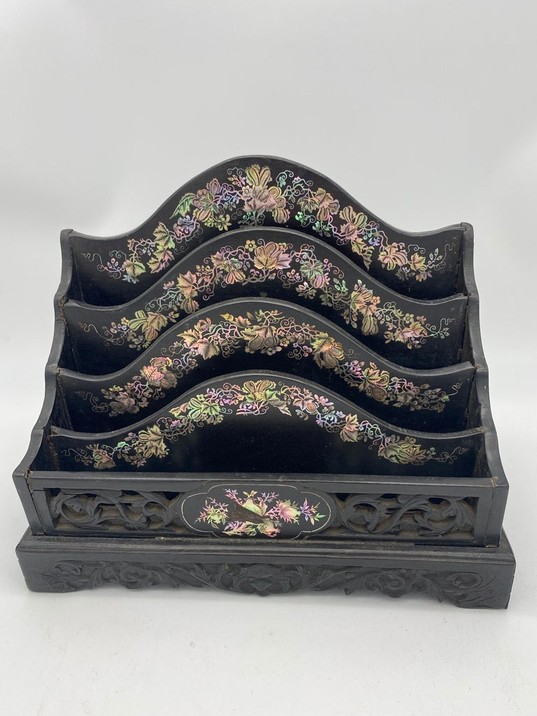 19th century Chinese ebonized letter rack with mother of pearl from the Qing dynasty. Beautiful mother of pearl of four divisional arched form above a scrolled leaf fret-cut frieze and carved cutout base 31ch wide, 16cmd deep, 26cm high.