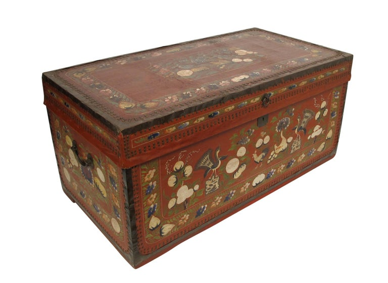A red pig skin leather trunk with hand-painted floral decoration and having nailhead trim. China, mid-19th century.