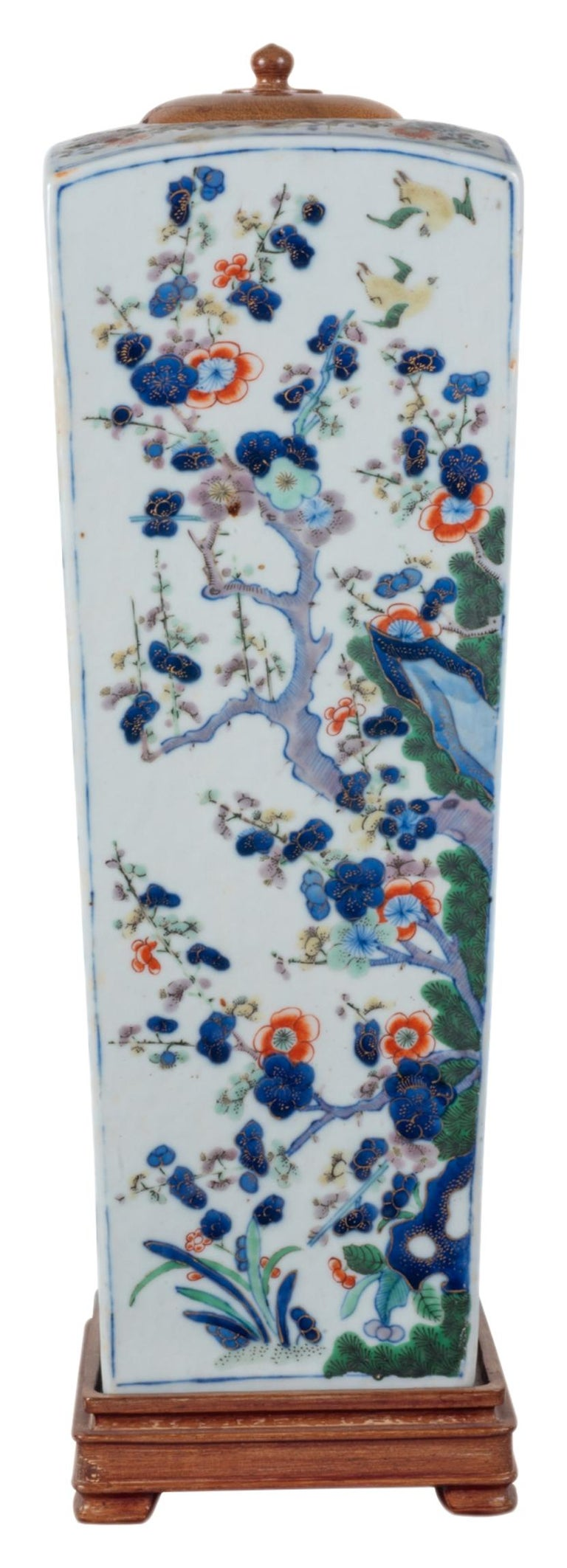 A good quality 19th century Chinese Famille Verte square tapering form vase or lamp. Having wonderful classical Prunus blossom trees and exotic flowers, with a wooden lid and base.
