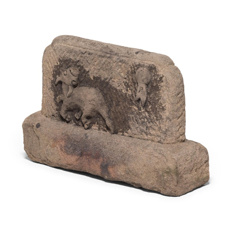 Generations have sat before this sculptural limestone fire screen, protected from sparks and warmed for hours by the heat retained in this thick block of stone. Hand-carved charming imagery and subtle etching, the hundred-year-old stone shows the