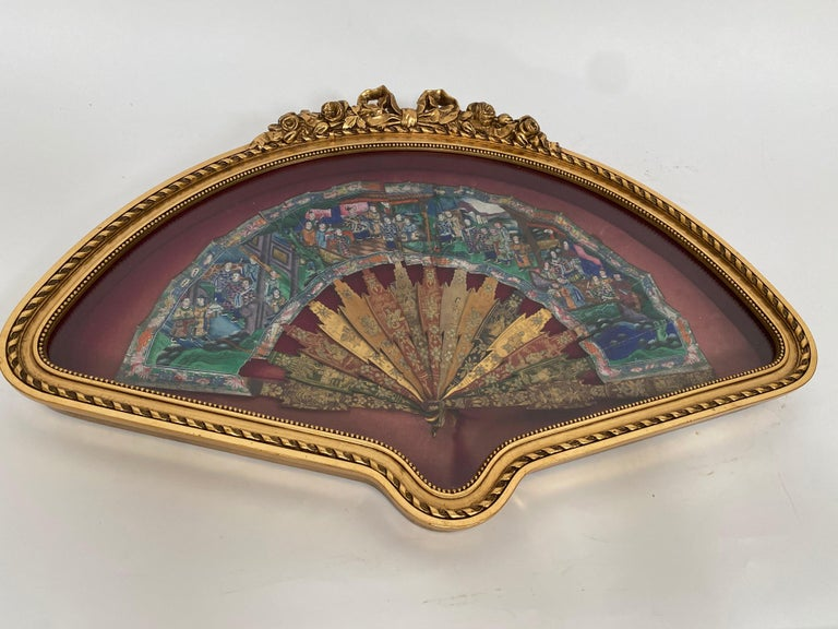 Antique 19th century hand painted Chinese fan with mother of pearl faces, Qing dynasty, the fan features black and gold lacquered handled a colorful screen with a figural, hand painted, scene in shades of blue, green, purple and brown and red. With