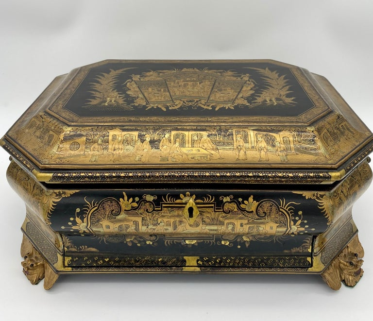 19th century Chinese lacquer sewing box from the Qing dynasty. Colored black and gold all-over beautifully with intricate designs.