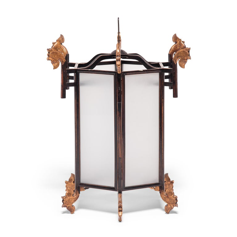 Embellished with carved and gilded lotus flowers, this ornate Chinese lantern would have originally been lit with candles to illuminate a very fine courtyard home in Northern China. Chinese lanterns have a history that goes back over 1,800 years to