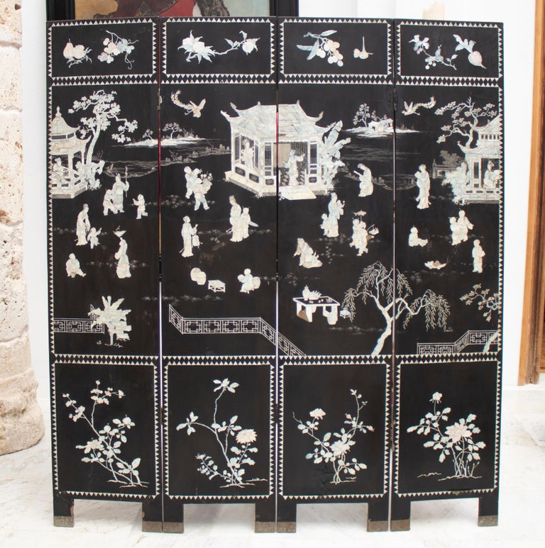 20th century Chinese black lacquered 4-panel folding screen decorated with mother of pearl inlay drawings. Has defects.