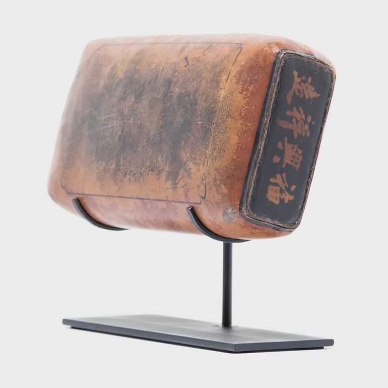 This extraordinary headrest made from lacquered hide in the Jiangxi region of China over 150 years ago calls to be touched. Its pliable design enabled contour comfort quite luxurious for the time. Some scholars think the soft curve and height could